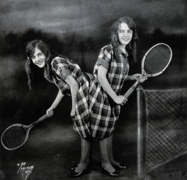 V0029598 Daisy and Violet Hilton, conjoined twins, ready for tennis.